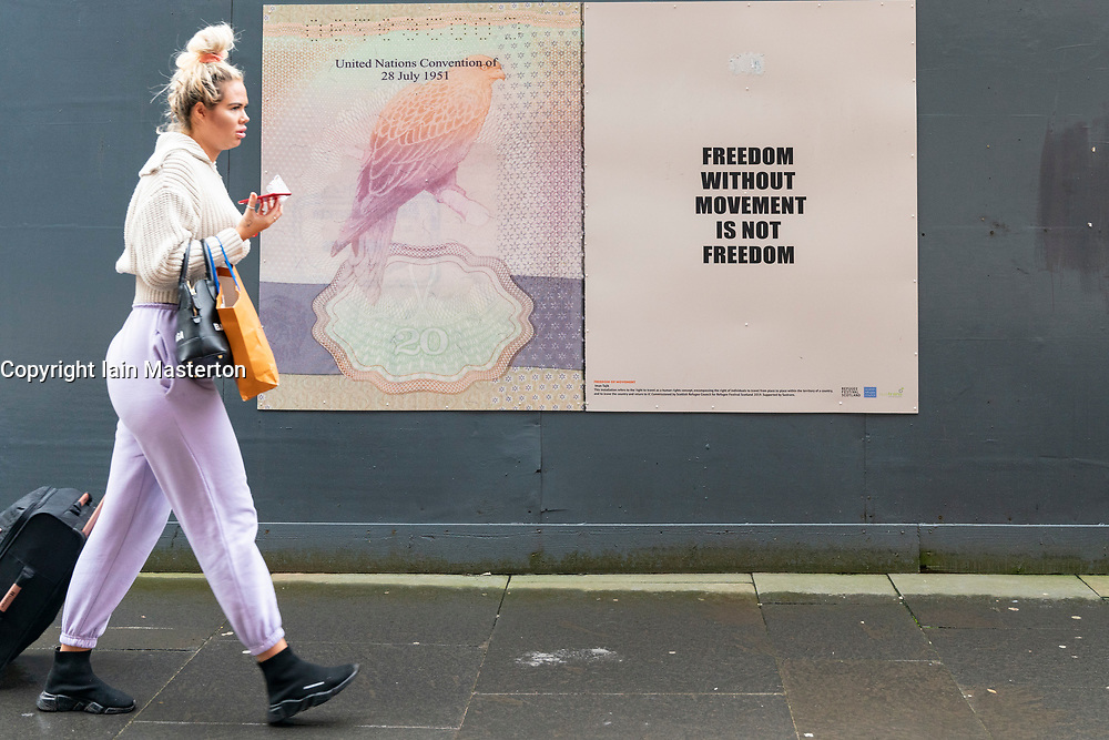 Glasgow, Scotland, UK.1 December 2020. Coronavirus health warnings, shop display and graffiti in Glasgow city centre. Pictured; Freedom without movement poster is pertinent to lockdown restrictions.  Iain Masterton/Alamy Live News
