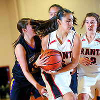 122012  Adron Gardner<br /> <br /> Grants Pirate Eileen Kugler (5) protects a rebound f at Grants High School Thursday.