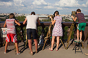 Moscow Russia, 30/07/2011..Tourists on a viewpoint on Sparrow Hills with panoramas of the city of Moscow.