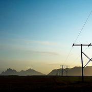 Electric powerline crossing the plains of Southeastern Iceland