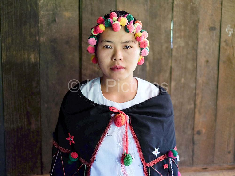 Portrait of Ma Prai Ta, a Yinbaw Kayan Kangan ethnic minority woman wearing her traditional costume at home in Daw We Ku village in Kayah State, Myanmar on 19th November 2016