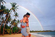 Couple Walking on Beach in Martinique With Rainbow