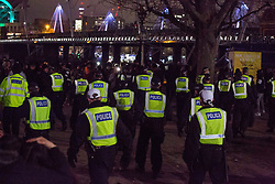 © Licensed to London News Pictures.01/01/2021, London, UK. Police disperse the crowd at South Bank in central London as three quarters of England plunged into Tier 4 last night. This New Year's Eve Londoners need to stay at home according to Tier 4 guidelines. Photo credit: Marcin Nowak/LNP