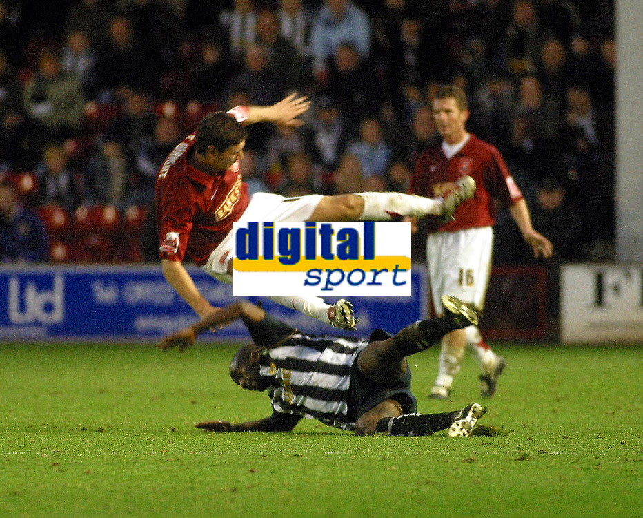 Photo: Dave Linney.<br />Walsall v Notts County. Coca Cola League 2. 25/11/2006.<br />County'sJay Smith (R) slides in to tackle  Tommy Wright.