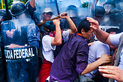10 SEPTEMBER 2003 - CANCUN, QUINTANA ROO, MEXICO: Protesters battle Mexican riot police during a protest against liberalizing agricultural trade at the WTO ministerial conference in Cancun. Tens of thousands of protesters, mostly farmers, came to Cancun for the fifth ministerial of the World Trade Organization (WTO). They were protesting against developed nations pushing to get access to agricultural markets in developing nations. The talks ultimately collapsed after no progress with no agreements reached between the participants.           PHOTO BY JACK KURTZ