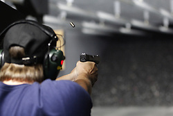 August 8, 2017 - San Diego, CA, USA - A Girl and a Gun Women's Shooting League San Diego Chapter spent a recent morning taking a classroom lesson at San Diego's Discount Gun Mart, then got out to the range to practice.  Eli Leary fired her Glock handgun downrange. (Credit Image: © John Gastaldo via ZUMA Wire)
