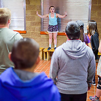 Ashley Boisclair gathers students around her for a lesson during the Young Americans summer camp at Crownpoint High School Thursday.