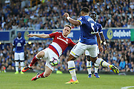 Adam Forshaw of Middlesbrough and Ashley Williams of Everton challenge for the ball. Premier league match, Everton v Middlesbrough at Goodison Park in Liverpool, Merseyside on Saturday 17th September 2016.<br /> pic by Chris Stading, Andrew Orchard sports photography.