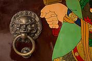 Decorative brass lion door knocker at Chenghuang Miao or City God Temple in Yu Yuan Gardens bazaar Shanghai, China