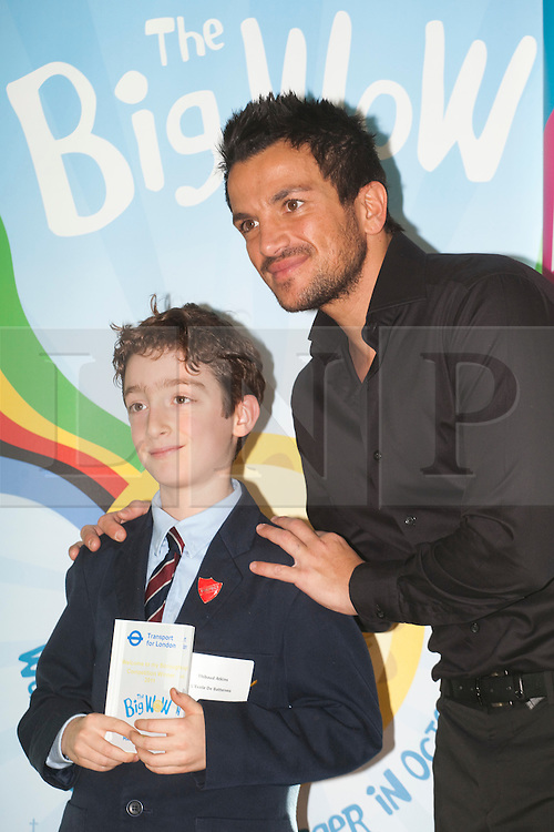 © Licensed to London News Pictures. 26/01/2012. London, England. Peter Andre with Thibaud Atkins from L'Ecole De Battersea. Today, 26 January, popstar and children's author Peter Andre presented twenty London school children with awards at City Hall for winning stories they have written about where they live, part of the Mayor of London's drive to improve literacy. The competition was also part of the Big WoW (Walk once a Week). Photo credit: Bettina Strenske/LNP
