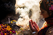 "29th January 2015, New Delhi, India. A woman prays to Djinns in the ruins of Feroz Shah Kotla in New Delhi, India on the 29th January 2015<br /> <br /> PHOTOGRAPH BY AND COPYRIGHT OF SIMON DE TREY-WHITE a photographer in delhi. + 91 98103 99809. Email:simon@simondetreywhite.com<br /> <br /> People have been coming to Firoz Shah Kotla to leave written notes and offerings for Djinns in the hopes of getting wishes granted since the late 1970's. Jinn, jann or djinn are supernatural creatures in Islamic mythology as well as pre-Islamic Arabian mythology. They are mentioned frequently in the Quran  and other Islamic texts and inhabit an unseen world called Djinnestan. In Islamic theology jinn are said to be creatures with free will, made from smokeless fire by Allah as humans were made of clay, among other things. According to the Quran, jinn have free will, and Iblīs abused this freedom in front of Allah by refusing to bow to Adam when Allah ordered angels and jinn to do so. For disobeying Allah, Iblīs was expelled from Paradise and called ""Shayṭān"" (Satan).They are usually invisible to humans, but humans do appear clearly to jinn, as they can possess them. Like humans, jinn will also be judged on the Day of Judgment and will be sent to Paradise or Hell according to their deeds. Feroz Shah Tughlaq (r. 1351–88), the Sultan of Delhi, established the fortified city of Ferozabad in 1354, as the new capital of the Delhi Sultanate, and included in it the site of the present Feroz Shah Kotla. Kotla literally means fortress or citadel."