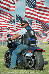 Air Force veteran Matthew Evans at the Field of Flags memorial at the Buffalo Chip Campground during the 75th Annual Sturgis Black Hills Motorcycle Rally.  SD, USA.  August 6, 2015.  Photography ©2015 Michael Lichter.