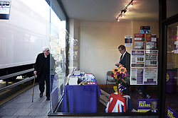 "© London News Pictures. ""Looking for Nigel"". A body of work by photographer Mary Turner, studying UKIP leader Nigel Farage and his followers throughout the 2015 election campaign. PICTURE SHOWS - A local man looks in through the window at Nigel Farage as he fiddles on his mobile phone, in the UKIP office in Ramsgate, Kent ahead of an 'Action Day', to help the party leader in his bid to become the local MP in South Thanet, on April 12th 2015. . Photo credit: Mary Turner/LNP **PLEASE CALL TO ARRANGE FEE** **More images available on request**"