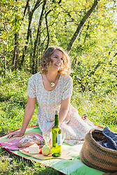 Beautiful woman preparing for a picnic in park, Bavaria, Germany