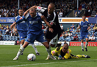 Photo: Paul Thomas.<br /> Oldham Athletic v Swansea City. Coca Cola League 1. 12/08/2006.<br /> <br /> Simon Charlton (L) of Oldham tries to fight of Lee Trundle, while Oldham keeper Chris Howarth (Yellow) watches.