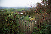 View over a garden gate towards Machynlleth from Melinbyrhedyn in Wales, United Kingdom.