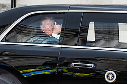London, UK. 3 June, 2019. President Trump waves from the Beast as leaves Westminster Abbey to travel to Clarence House on the first day of his state visit to the UK.