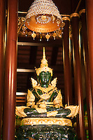 Phra Kaew Marakot Buddha Image at Wat Phra Kaew.  In 1434 after its chedi was struck by lightning revealing the Phra Kaew Marakot Buddha within. Now a replica Phra Kaew Marakot image, made of Canadian jade, stands within the temple today.