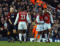 Thierry Henry (Arsenal) is congratulated after scoring as Sol Campbell (Arsenal) and Danny Mills (Middlesbrough) have words. Arsenal v Middlesbrough, Highbury, 10/01/2003, Premiership Football. Credit : Colorsport / Robin Hume. Digital File Only.