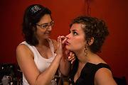 Makeup artist Julie Arnheim putting makeup on a dancer.