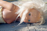 close up of doll laying on pavement