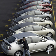 The 2004 Toyota Prius hybrid cars at the Port of Long Beach are readied for shipment to local dealers.