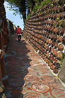 """Tokoname pottery town's famous """"Pottery Walk"""" passes by kilns, potters, shops and ceramics embedded into the sidewalk and walls making for a colorful stroll through one of Japan's most famous centers of ceramics."""