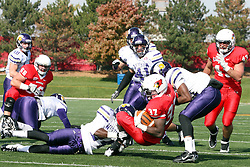 05 November 2011:  Darrelynn Dunn gets stopped by Ethan Bachinski and Maurice Hood during an NCAA football game between the Western Illinois Leathernecks and the Illinois State Redbirds at Hancock Stadium in Normal IL