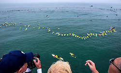 June 20, 2017 - Huntington Beach, California, USA - As spectators watch from the Huntington Beach Pier in Huntington Beach, surfers paddle into place just north of the as they create the world's largest paddle out ''Surfing Circle of Honor'' in Huntington Beach Tuesday morning, June  20, 2017. (Photo by Mark Rightmire, Orange County Register/SCNG) (Credit Image: © Mark Rightmire, Mark Rightmire/The Orange County Register via ZUMA Wire)
