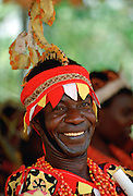 Man in brightly coloured clothes at a Tribal Festival in Nigeria RESERVED USE - NOT FOR DOWNLOAD -  FOR USE CONTACT TIM GRAHAM