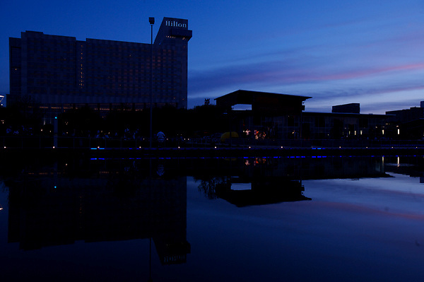 Stock photo of the silhouette of the Lake House cafe and Hilton hotel as night falls