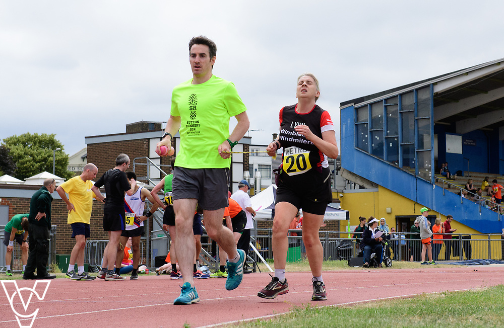 Event: 5000 meter relay<br /> Competitors, from left: Lynn Cox<br /> <br /> Metro Blind Sport's 42nd Athletics Open, held at Mile End Stadium, Tower Hamlets, London.<br /> <br /> Picture: Chris Vaughan Photography for Metro Blind Sports<br /> Date: June 16, 2018