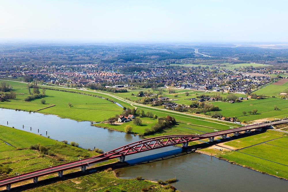Nederland, Gelderland - Overijssel, Hattem, 01-05-2013; IJsselbrug, spoorbrug bij Hattem voor de Hanzelijn. Hattem in de achtergrond.<br /> De 'Hanzeboog' is ontworpen door  Quist Wintermans Architecten.<br /> The red railway bridge Hanzeboog (Hanseatic arch) over the IJssel near Zwolle, has been designed by Quist Wintermans Architects. <br /> luchtfoto (toeslag op standard tarieven);<br /> aerial photo (additional fee required);<br /> copyright foto/photo Siebe Swart