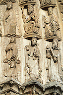 West Facade, Central Portal, Archivolts- Right c. 1145. Cathedral of Chartres, France . Gothic statues of figures, from  the center the inner archivolt contains figures of angels standing on clouds. They hold round objects. (Perhaps these are wheels- the symbol for the Thrones, one of the choirs of angels described in Old Testament Book of Ezekiel 1:13-19. - JV) .The outer archivolts (right) contain figures of the Elders of the Apocalypse (Apocalypse, Chapter 4). They are depicted as bearded, haloed men wearing crowns seated on thrones. Each holds a musical instrument (Apocalypse, 5:8). A UNESCO World Heritage Site. .<br /> <br /> Visit our MEDIEVAL ART PHOTO COLLECTIONS for more   photos  to download or buy as prints https://funkystock.photoshelter.com/gallery-collection/Medieval-Middle-Ages-Art-Artefacts-Antiquities-Pictures-Images-of/C0000YpKXiAHnG2k