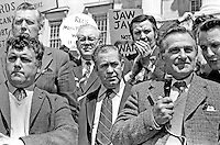 UWC (Ulster Workers Council) Strike. Strike leaders addressing supporters in front of Parliament Building at Stormont, Belfast, N Ireland, UK. Shortly after this protest the Executive resigned. Included in photograph are Rev Ian Paisley (second row, left), Harry Murray (with microphone) and Harry Patterson (centre). Ref: 197405280113<br />