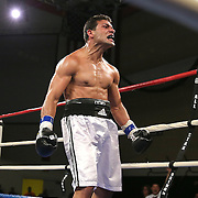 """Moises Hernandez (white shorts) beats Asaac Smith during a """"Boxeo Telemundo""""  boxing match at the Kissimmee Civic Center on Friday, July 18, 2014 in Kissimmee, Florida.  (AP Photo/Alex Menendez)"""