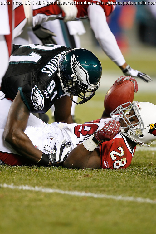27 Nov 2008: Philadelphia Eagles defensive end Chris Clemons #91 takes down Arizona Cardinals running back J.J. Arrington #28 during the game against the Arizona Cardinals on November 27th, 2008. The Eagles won 48 to 20 at Lincoln Financial Field in Philadelphia, Pennsylvania.