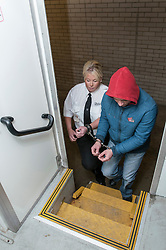 Prisoner being escorted to the transport in cuffs in Southampton Crown Court