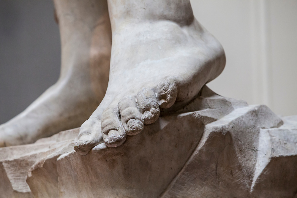 """The left foot of """"David"""" a sculpture by Michaelangelo. Gallery of the Academy of Florence, Italy."""