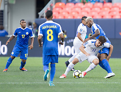 July 13, 2017 - Denver, Colorado, U.S - El Salvador F RODOLFO ZELAYA, right, runs into Curacao traffic during the 2nd. Half at Sports Authority Field at Mile High during the CONCACAF Gold Cup tournament Thursday night. El Salvador beats Curacao 2-0. (Credit Image: © Hector Acevedo via ZUMA Wire)