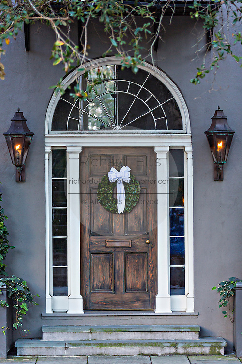 Christmas wreath on a door of a historic home in Charleston, South Carolina.
