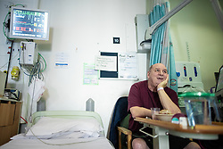 © Licensed to London News Pictures . 12/02/2021 .  Manchester , UK . Patient PAUL DUPLEX (60), who is celebrating his 60th birthday today (12th February 2021) by his bed on a bay on Ward 4 , the Respiratory Cohort Area . Inside Manchester Royal Infirmary , where patients are being treated for the effects of Coronavirus . Photo credit : Joel Goodman/LNP
