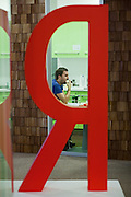 Moscow, Russia, 26/03/2012..A staff member has lunch in a canteen inside the Silicon Valley style headquarters of Russian internet search company Yandex.