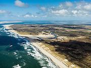 Nederland, Noord-Holland, Texel, 16-04-2012; De Slufter, gezien in noordelijke richting, vanaf de Noordzee. Op het tweede plan De Cocksdorp, Waddenzee aan de horizon, links Vliehors en Vlieland .Het natuurgebied, een duinvalllei met kreken, is ontstaan doordat de duinen in het verleden doorgebroken zijn. De Sluftervallei staat in open verbinding met de Noordzee en wordt beïnvloed door eb en vloed..View on natural area The Slufter of the isle of Texel, beach, dunes and the Northsea..luchtfoto (toeslag), aerial photo (additional fee required);.copyright foto/photo Siebe Swart