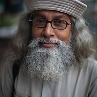 A portrait of a Bangladeshi gentleman in the street in old Dhaka, Bangladesh