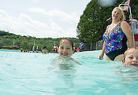 Aubrielle Gibson gets cooled off in the pool following the 70th Anniversary celebration of the Kiwanis Pool in St. Johnsbury Vermont.  Karen Bobotas / for Kiwanis International