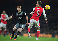 Football - 2016 / 2017 League [EFL] Cup - Quarter-Final: Arsenal vs. Southampton<br /> <br /> Harrison Reed of Southampton and Aaron Ramsey tussle for the ball at The Emirates <br /> <br /> COLORSPORT/ANDREW COWIE