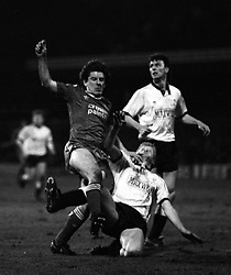 Peter Beardsley (Liverpool, l) tries to avoid a tackle