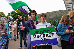 Edinburgh, Scotland, UK. 2nd September 2021.Demonstration supporting women's rights held outside The Scottish Parliament at Holyrood in Edinburgh today. Protesters believe that the definition of a women is under threat from Scottish Government law that would give trans-women the same rights as women. The slogan Women Won't Wheesht has been adopted to promote their movement.  A counter demonstration was also held by proponents of trans people's rights. Insults were exchanged between both groups. Pic; Women in Suffragette costume .  Iain Masterton/Alamy Live News.