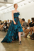 Aqua and navy print strapless dip hem gown. By Carmen Marc Valvo at the Spring 2013 Fashion Week show in New York.